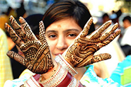 Karwa Chauth ritual of applying Mehndi.